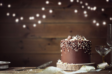 Chocolate celebration cake in a party setting