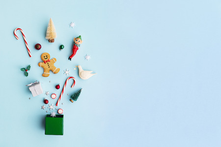 Collection of Christmas objects in a gift box viewed from above