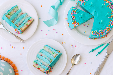 Birthday cake with colorful frosting and sprinkles Stok Fotoğraf - 98264144
