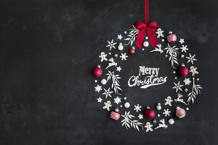 Christmas objects laid out in the shape of a wreath, overhead view