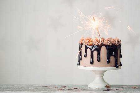 Chocolate drip cake with sparkler for a birthday or celebration Stockfoto