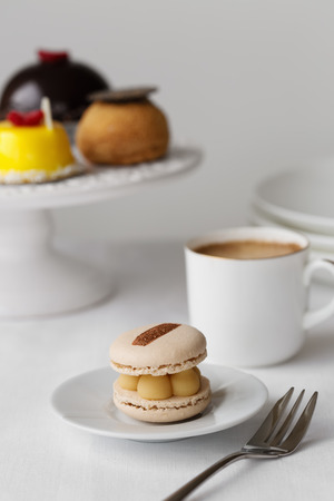 Elegant afternoon tea with cakes and macaron