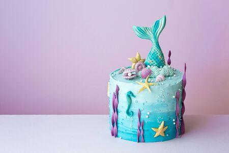 Mermaid birthday cake on a purple background Banco de Imagens