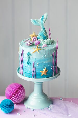 Mermaid birthday cake decorated with seashells