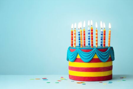 Brightly colored birthday cake with colorful candles