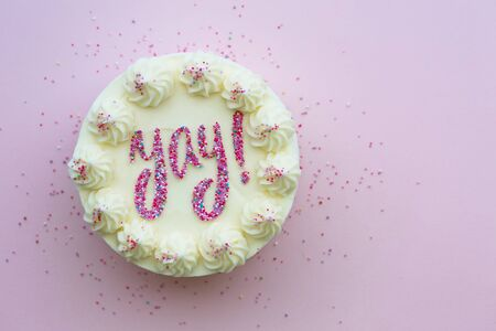 Birthday cake with yay written in colorful sprinkles Banco de Imagens