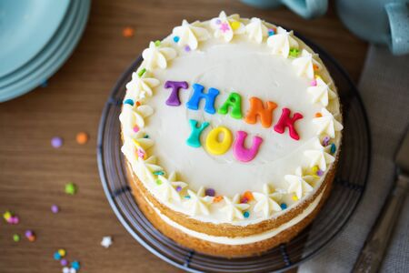 Cake with colorful rainbow letters spelling thank you
