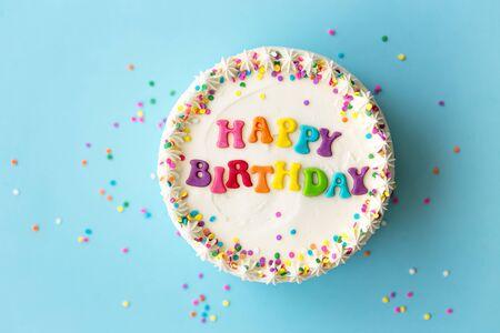 Happy birthday cake with rainbow lettering Banco de Imagens