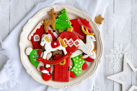 Decorated gingerbread cookies on a plate Banco de Imagens