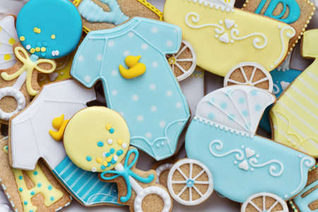 Assortment of decorated baby shower cookies, overhead view