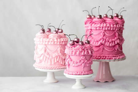 Three pink vintage style piped buttercream celebration cakes