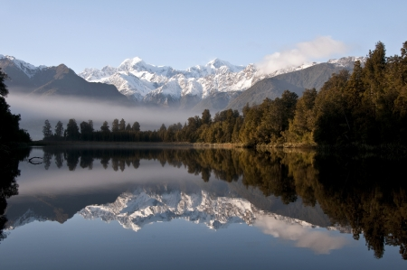 south island new zealand: Lake Matheson, South Island, New Zealand - Reflection of Mount Tasman and Mount Cook