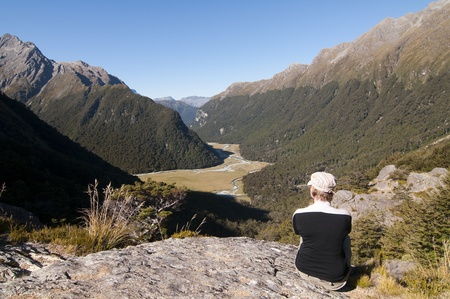fiordland: Tramper looking out over Routeburn Flats - Routeburn Track, South Island, New Zealand Stock Photo