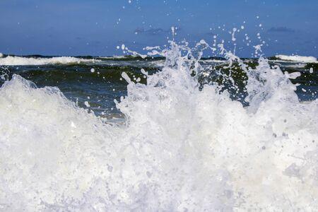 Powerful shore break of a big wave