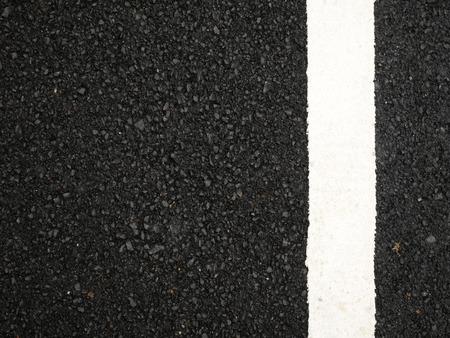 Black paved road background.