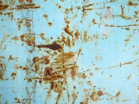 Background rust stains on metal plates.