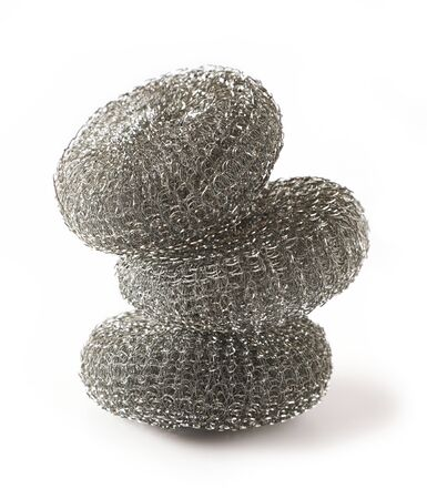 stack of metallic sponges isolated on a white background