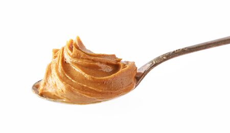 spoon of peanut butter isolated on white background