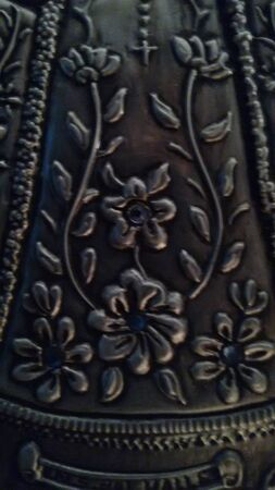 Embossed metal texture with flowers