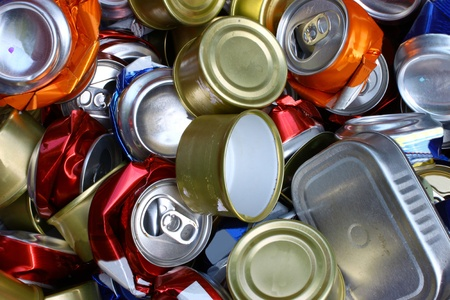 A bunch of crushed alumnium cans all together for recycling to help be green for the Earth and to be enviromentaly friendly Stock Photo
