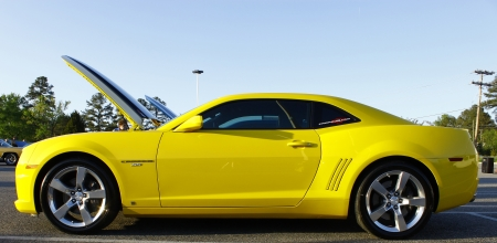 GLOUCESTER, VA- APR 13:Profile of a Yellow Chevy Camaro at the 2nd Annual 2012 MPCC (middle penninsula car club) meeting at the Main St shopping center in Gloucester Virginia, 2012 in Gloucester Virginia on April 13, 2012. photo