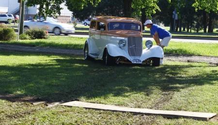 chrome man: HAMPTON, VA-JUNE 9:Directing the cars in at the 3rd annual HCS car show at the Hampton Christian School in Hampton Virginia, 2012 in Hampton Virginia on June 9, 2012.