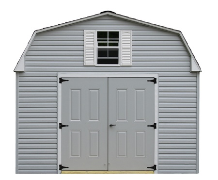 A nice new gray storage shed isolaed on white with room for your text. 免版税图像