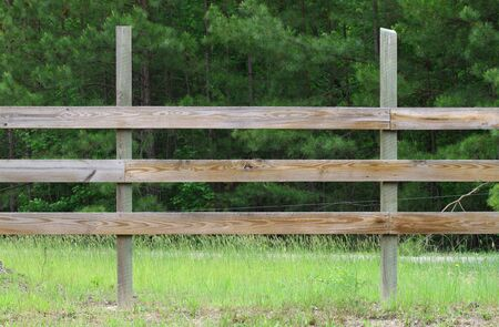 breaking down: A wooden farmers horse fence breaking down the rule of thirds in a pattern visible to anyone with room for your text. Stock Photo