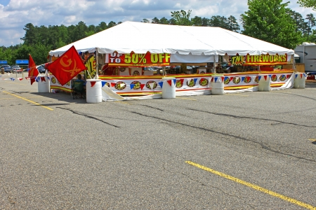 GLOUCESTER,VA,USA-JUNE 30: A traveling vendors popup Fireworks tent for selling fireworks for July 4th in Gloucester Wal Marts parking lot June 30,2011 in Gloucester,VA,USA