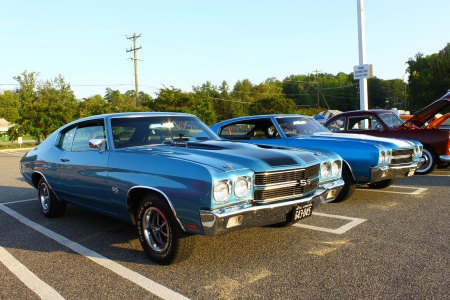 GLOUCESTER, VA, USA -SEPTEMBER 9:Two Vintage 1970 Chevrolet Chevelle SS 454s in the Middle Peninsula Classic Cruisers Club weekly Car Show. Main Street Center. September 9, 2011 in Gloucester, VA, USA Editorial