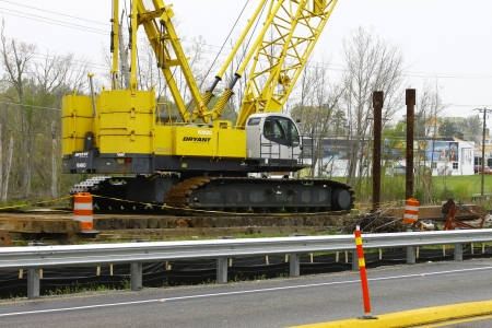 GLOUCESTER, VA, USA - MARCH 31:A large crane sitting on cross ties atThe bridge replacement project over the ware river on Main Street. on March 31, 2012 in Gloucester, VA, USA