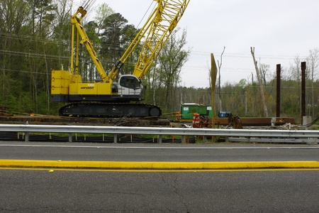 GLOUCESTER, VA, USA - MARCH 31:A large crane sitting on cross ties at the bridge replacement project over the ware river on Main Street. on March 31, 2012 in Gloucester, VA, USA
