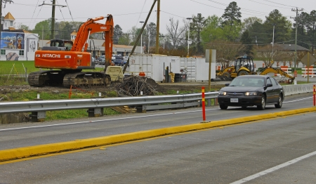 GLOUCESTER, VA, USA - MARCH 31:An excavator and equipment trailers at the bridge replacement project over the ware river on Main Street. on March 31, 2012 in Gloucester, VA, USA