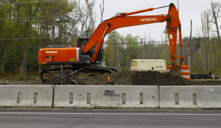 GLOUCESTER, VA, USA - MARCH 31:A large excavator and air compressor at the bridge replacement project over the ware river on Main Street. on March 31, 2012 in Gloucester, VA, USA