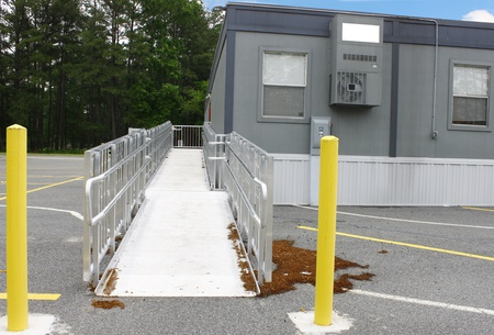 threw: The entrance ramp into a series of temporary modular units with AC setup in the parking lot for the kids displaced by a tornado that tore threw their School in April of 2011