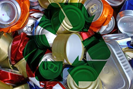 international recycle symbol: A bunch of crushed alumnium cans all together for recycling to help be green for the Earth and to be enviromentaly friendly with the international recycle symbol. Stock Photo