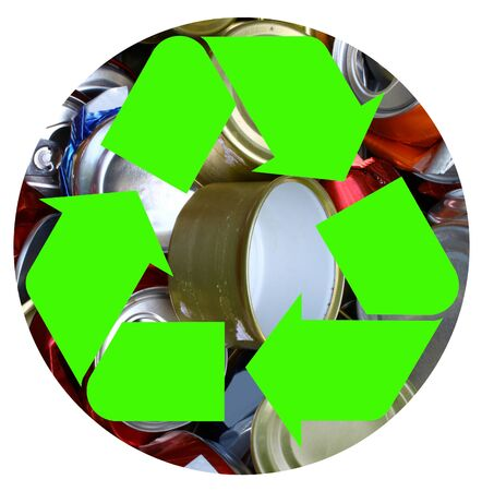 The international recycle symbolon top of a bunch of crushed aluminum cans in a circle representing the Earth isolated on white