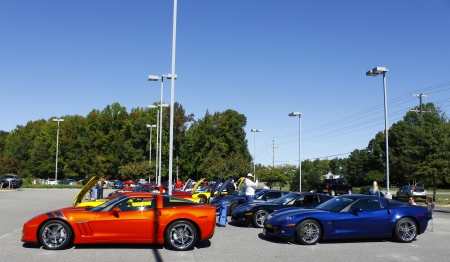 Humane: GLOUCESTER, VA- OCTOBER 13:A line of Corvettes at the Ken Houtz Chevrolet Buick, Camaro VS Corvette Humane Society car show and food drive in Gloucester, Virginia on October 13, 2012 Editorial