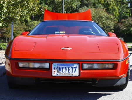 GLOUCESTER, VA- OCTOBER 13:An old red Corvette at the Ken Houtz Chevrolet Buick, Camaro VS Corvette Humane Society car show and food drive in Gloucester, Virginia on October 13, 2012