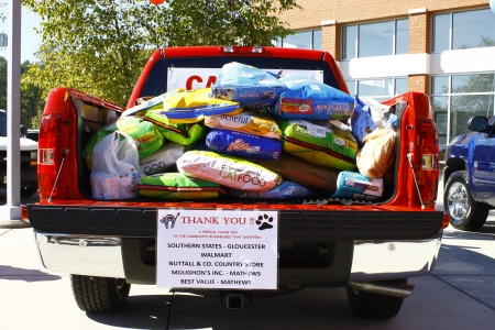 Humane: GLOUCESTER, VA- OCTOBER 13:Pickup full of dog food at the Ken Houtz Chevrolet Buick, Camaro VS Corvette Humane Society car show and food drive in Gloucester, Virginia on October 13, 2012