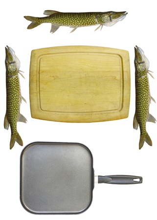 pickerel: An old wooden cutting board isolated on white with a square non-stick frying pan and three chain pickerel