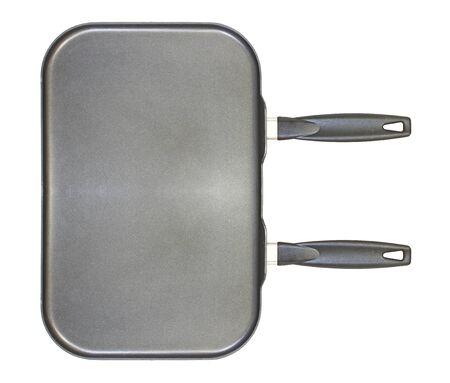 dual: A large non stick dual burner frying pan isolated on white