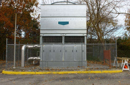 fuel provider: A large barbed wire fenced in industrial heat pump AC system for a large facility
