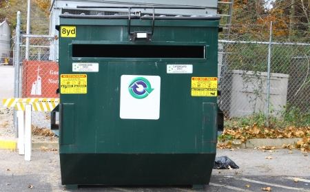 A large green cardboard only recycling dumpster Stock Photo
