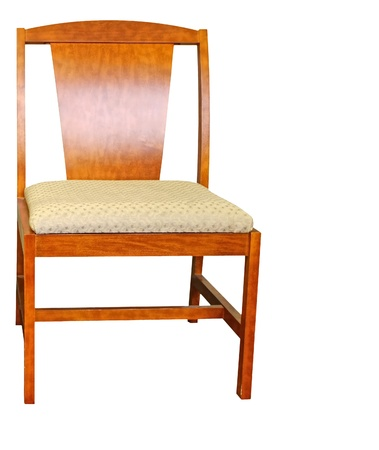 cushioned: A cushioned wooden high back chair against a wall on a rug Stock Photo