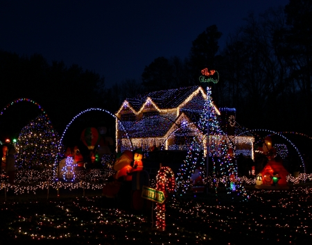 colorful light display: A Home decorated and lighted with 650,000 lights and over 60 inflatables for Christmas and for New Year Eve at Night in Virginia