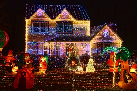 house outside: A Home decorated and lighted with 650,000 lights and over 60 inflatables for Christmas and for New Year Eve at Night in Virginia