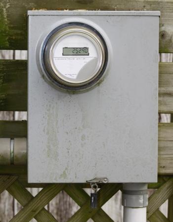 metering: An old dirty modern digital electrical metering box