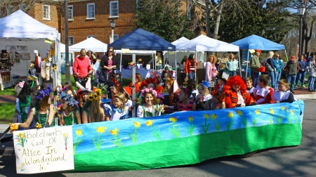 heralds: GLOUCESTER, VIRGINIA - APRIL 6: Botetourt elementary kids float in the Daffodil Parade on April 6, 2013 in Gloucester, Virginia. In its 27th year, the parade heralds the arrival of spring.
