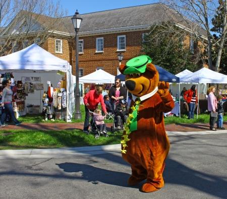 heralds: GLOUCESTER, VIRGINIA - APRIL 6: Yogi Bear in the Daffodil Parade on April 6, 2013 in Gloucester, Virginia. In its 27th year, the parade heralds the arrival of spring.
